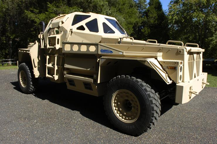 050907-N-7676W-011 Quantico, Va. (Sept. 7, 2005) - The Ultra Armored Patrol Vehicle is a research project funded by the Office of Naval Research (ONR), at the Georgia Technology Research Institute. The project's goal is to develop a prototype vehicle that demonstrates improved ballistic and mine protection technologies. An innovative survivable crew capsule, which utilizes a new combination of armor materials, is mounted on a commercial truck chassis. Faceted crew capsule geometries are being used to provide better deflection of pressure waves from blasts when compared to current configurations. The Ultra is slightly larger than the High Mobility Multipurpose Wheeled Vehicle (HMMWV) and is diesel powered. U.S. Navy photo by Mr. John F. Williams (RELEASED)